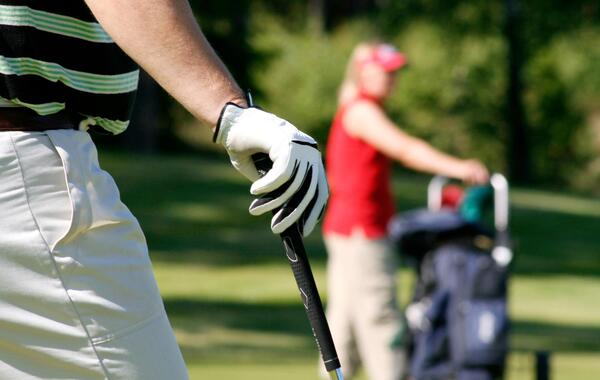 Golfer Holding Club in Fairway
