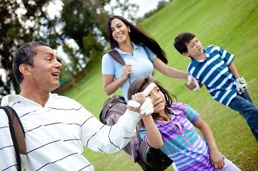 family, dad, mom, kids golfing