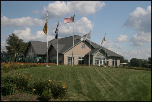 university golf club clubhouse small image with flags