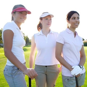 three women golfing