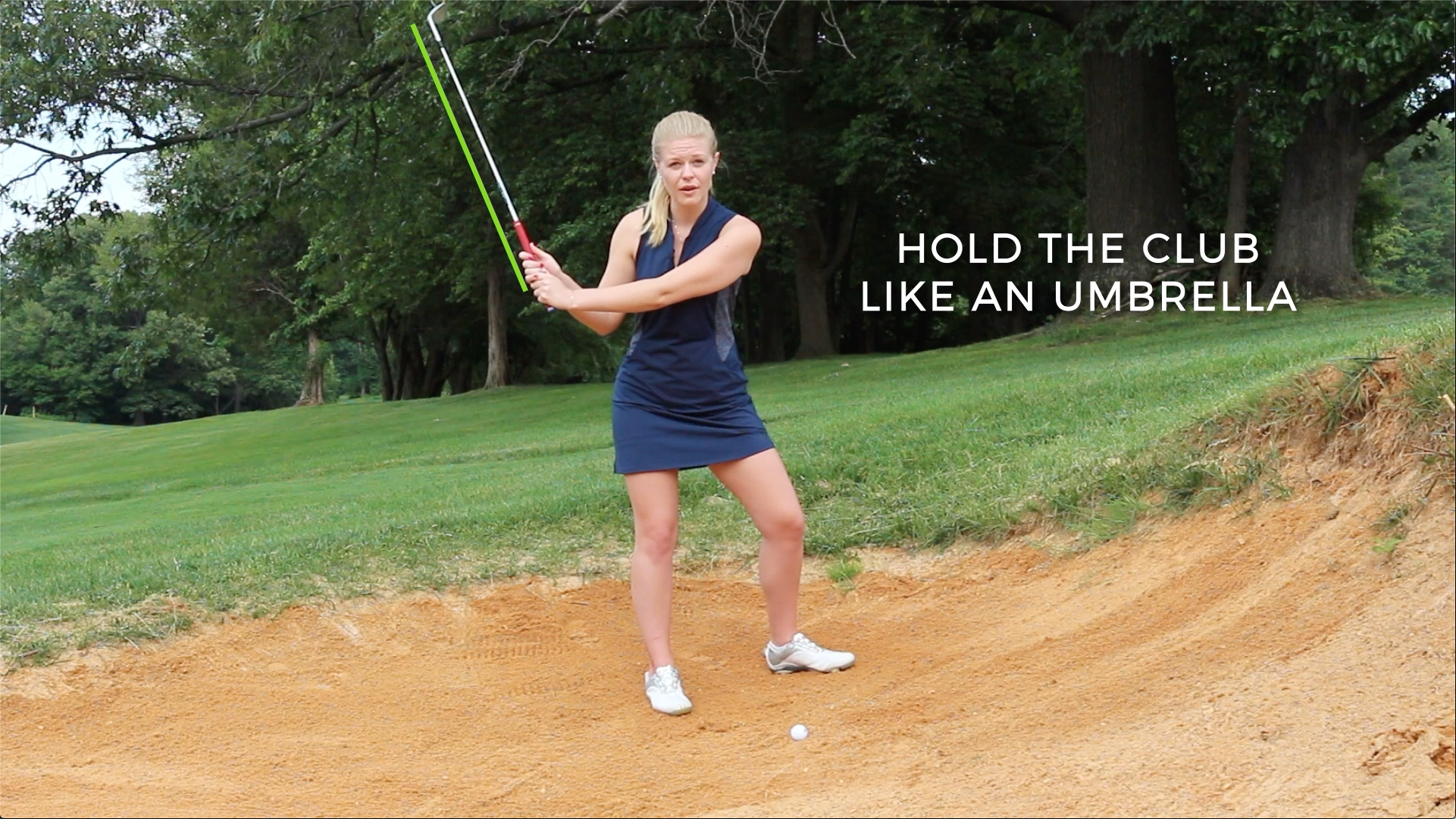 Holding the club up closer to your ears, like an umbrella, is better for hitting out of the sand
