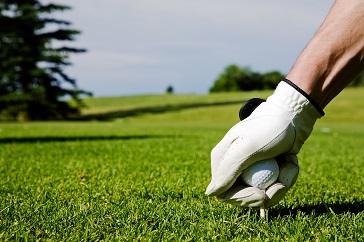 Golfer Placing Ball on Tee