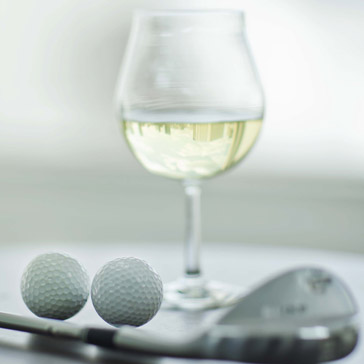 Wine glass and golf clubs at a Billy Casper Golf Course