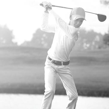 junior guy boy golfer swing