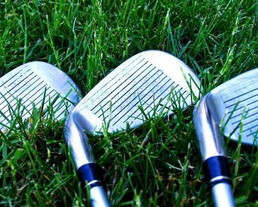 golf clubs in grass
