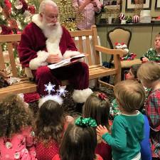 Santa Readying To Kids