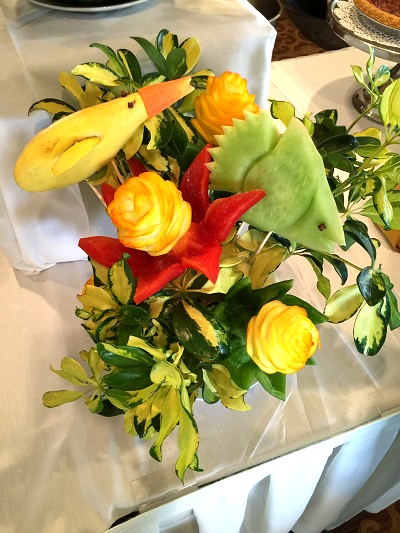 Colony West Events and Banquets - fruit fish and roses