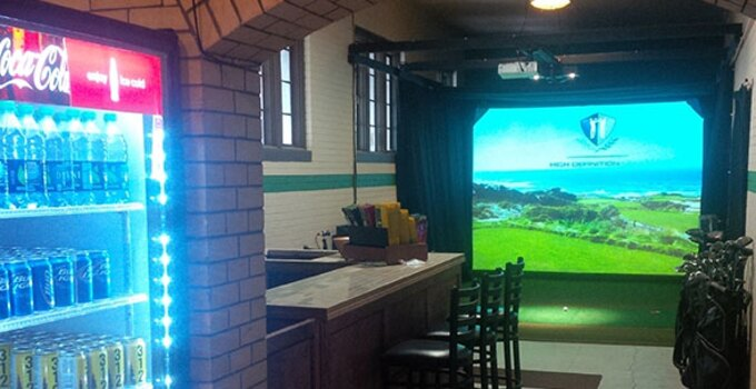 Try out the Sydney R. Marovitz Golf Simulator