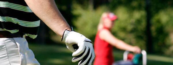 Golf with Two Golfers Holding Club in Fairway