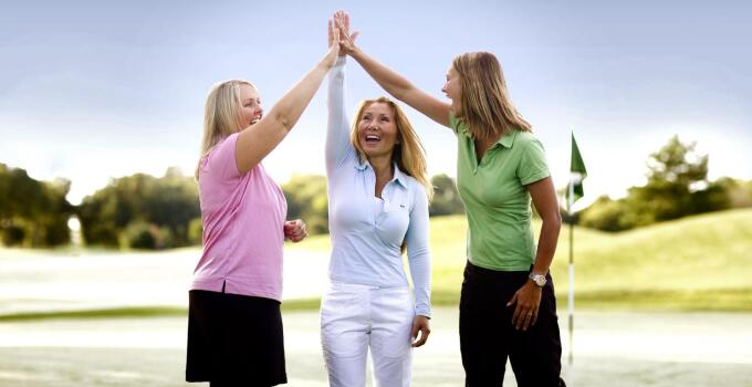 Having with friends on the golf course.