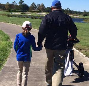 David Evangelista, RDM for Southeast at BCG, and his daughter enjoy a round of golf.