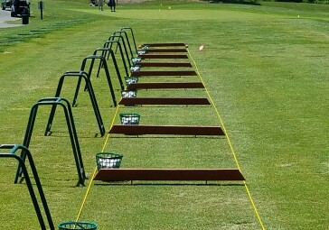 the grass driving range at forest greens