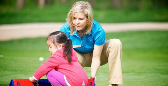 Tiffany Faucette, 1757 Golf Instructor, teaching a golf lesson
