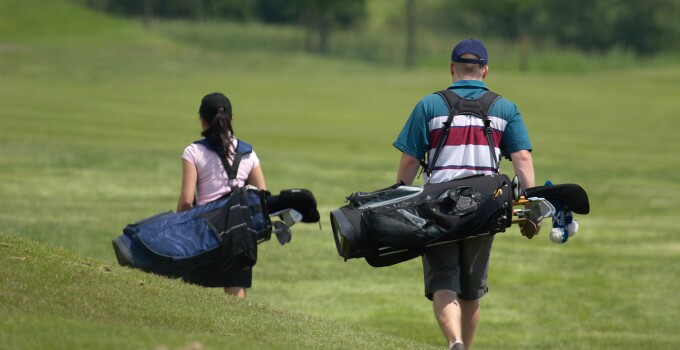 Father and daughter golfing together