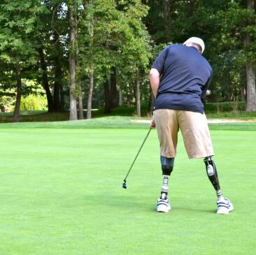 Wounded Warrior playing golf in the World's Largest Golf Outing