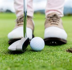 Photo: Golfer, Shoes, Putter, Hole